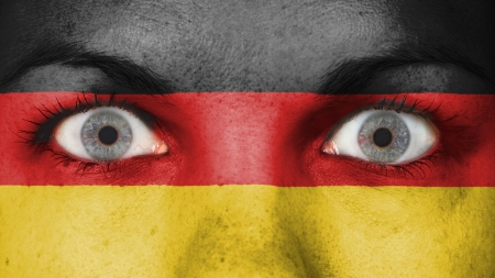 Close up of eyes. Painted face with flag of Germany photo
