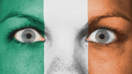 Close up of eyes. Painted face with flag of Ireland photo