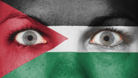rooting: Close up of eyes. Painted face with flag of Jordan Stock Photo
