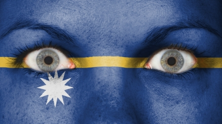 rooting: Close up of eyes. Painted face with flag of Nauru