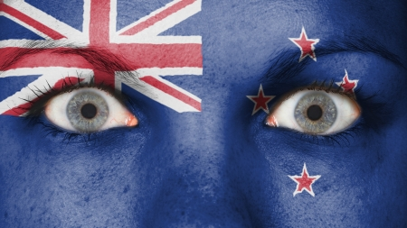 Close up of eyes. Painted face with flag of New Zealand photo