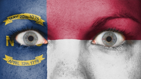 rooting: Close up of eyes. Painted face with flag North Carolina