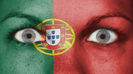 Close up of eyes. Painted face with flag of Portugal photo