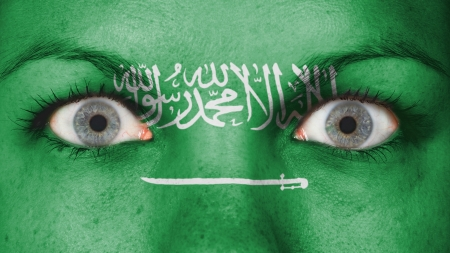 rooting: Close up of eyes. Painted face with flag of Saudi Arabia