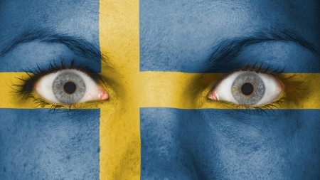 Close up of eyes. Painted face with flag of Sweden
