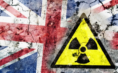 uranium: Old cracked wall with radiation warning sign and painted flag, flag of United Kingdom