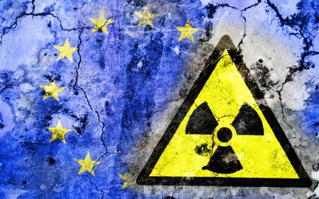 Old cracked wall with radiation warning sign and painted flag, flag of the European Union Stock Photo - 24138014