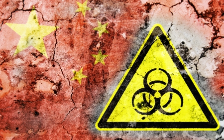 polonium: Old cracked wall with biohazard warning sign and painted flag, flag of China