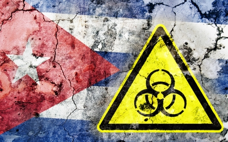 polonium: Old cracked wall with biohazard warning sign and painted flag, flag of Cuba