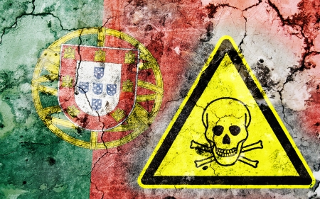 portugese: Old cracked wall with poison warning sign and painted flag, flag of Portugal
