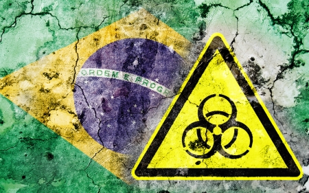 polonium: Old cracked wall with biohazard warning sign and painted flag, flag of Brazil Stock Photo
