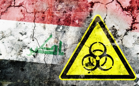 polonium: Old cracked wall with biohazard warning sign and painted flag, flag of Iraq Stock Photo