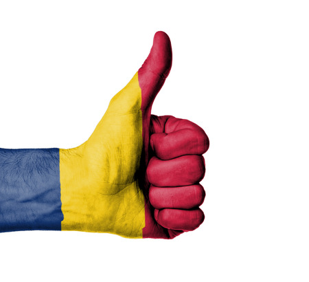 chad: Closeup of male hand showing thumbs up sign, flag of Chad