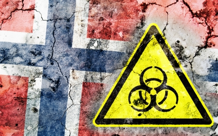polonium: Old cracked wall with biohazard warning sign and painted flag, flag of Norway
