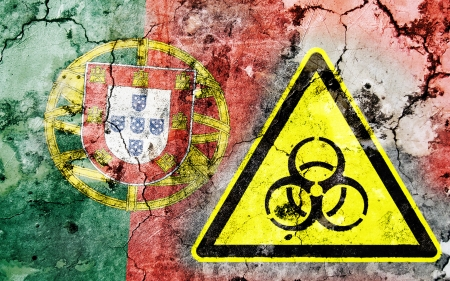 portugese: Old cracked wall with biohazard warning sign and painted flag, flag of Portugal