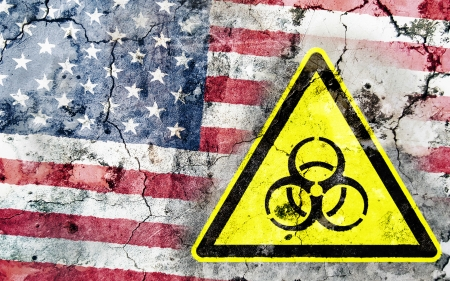 Old cracked wall with biohazard warning sign and painted flag, flag of the United States Stock Photo - 24196026