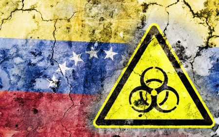 polonium: Old cracked wall with biohazard warning sign and painted flag, flag of Venezuela Stock Photo