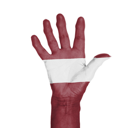 Palm of a woman hand, painted with flag of Latvia photo