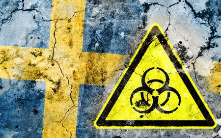 polonium: Old cracked wall with biohazard warning sign and painted flag, flag of Sweden