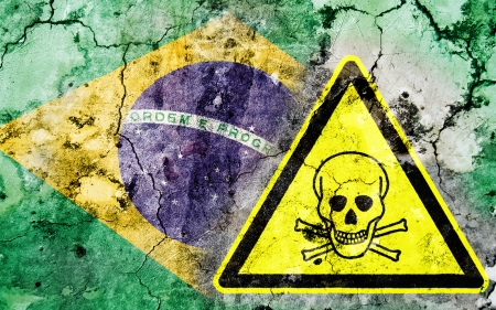 poison sign: Old cracked wall with poison warning sign and painted flag, flag of Brazil Stock Photo