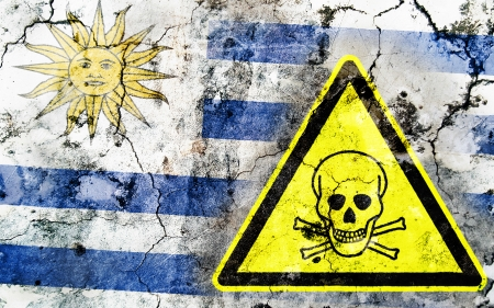 poison sign: Old cracked wall with poison warning sign and painted flag, flag of Uruguay