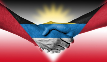 Man and woman shaking hands, wrapped in flag pattern, Antigua and Barbuda photo