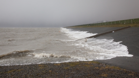 Extreme high tide at the dikes of the dutch coastal works
