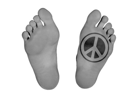 Human feet isolated on white, peace symbol photo