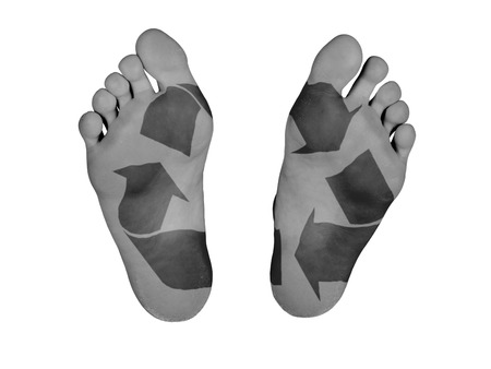 Human feet isolated on white, recycle symbol photo