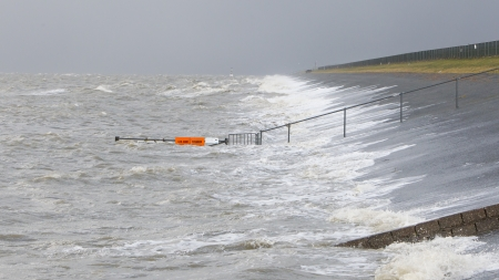 dikes: Extreme high tide at the dikes of the dutch coastal works