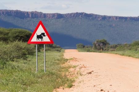 Warthog Road Crossing Sign photo