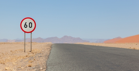 kph: Speed limit sign at a desert road in Namibia, speed limit of 60 kph
