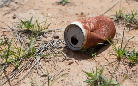 Old rusty beverage can in the Namibian desert