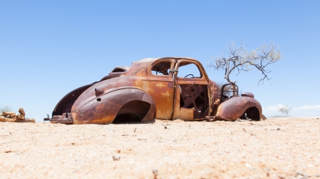 Abandoned car in the Namib Desert, Namibia photo