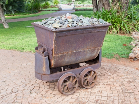 Rusted old mining carriages filled with stones, Namibia photo