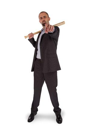 Portrait of angry businessman holding baseball bat over white background photo