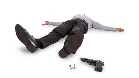 Businessman lying dead in the floor with a gun