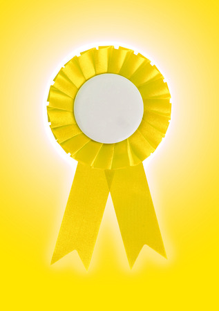 Award ribbon isolated on a white background, yellow photo