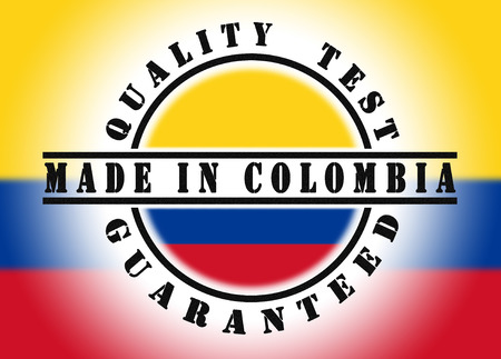 Quality test guaranteed stamp with a national flag inside, Made in Colombia photo