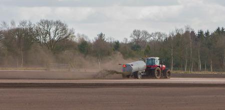 Application of manure on arable, dutch farmland photo