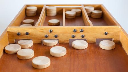 Typical dutch wooden boardgame - Sjoelen - Selective focus