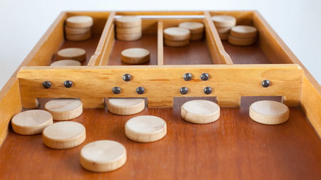 Typical dutch wooden boardgame - Sjoelen - Selective focus