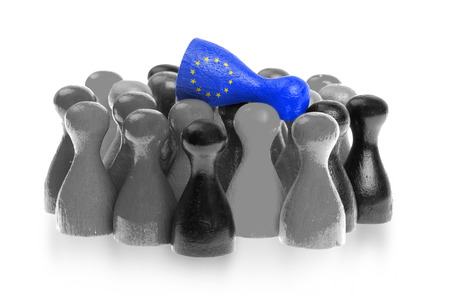 pion: One unique pawn on top of common pawns, flag of the European Union Stock Photo