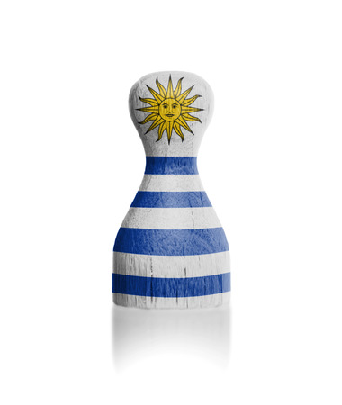 boardgames: Wooden pawn with a painting of a flag, Uruguay Stock Photo
