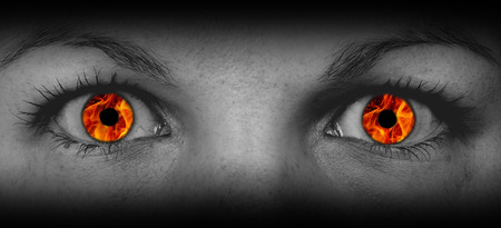 skin burns: Detail view of female eyes with flames instead of the iris