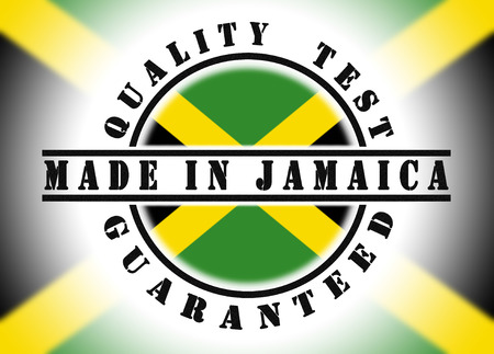 Quality test guaranteed stamp with a national flag inside, Jamaica photo