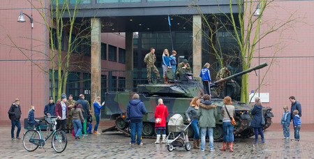 leeuwarden: Leeuwarden, The Netherlands - april 6: Civilians can for once see and climb a dutch Combat Vehicle 90 in the city of Leeuwarden on April 6, 2014.