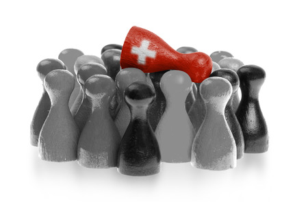 pion: One unique pawn on top of common pawns, flag of Switzerland Stock Photo
