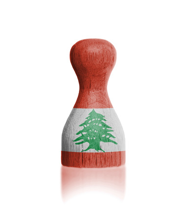 Wooden pawn with a painting of a flag, Lebanon photo