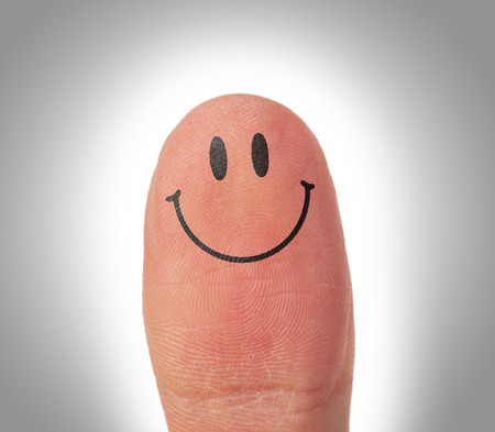 Female thumbs with smile face on the finger, happy